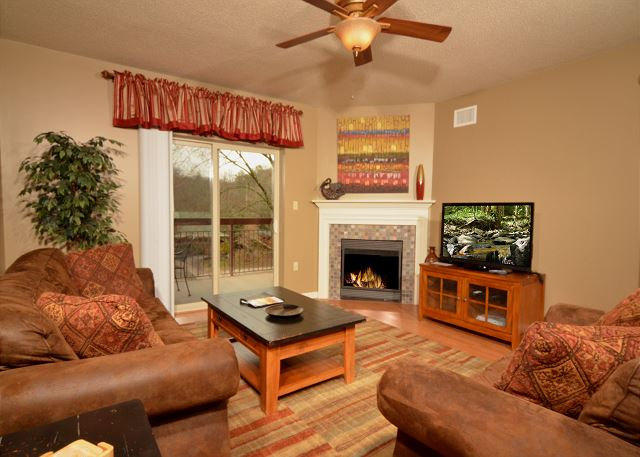 Living Room with Hardwood Floor, Flat Screen TV and Seasonal Gas Fireplace