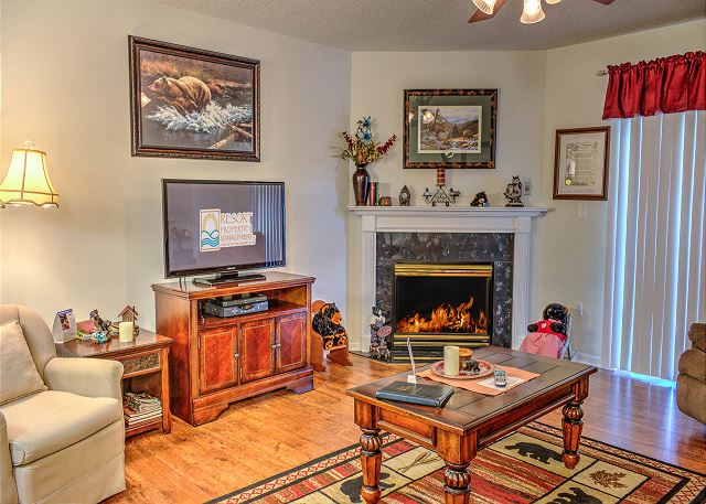 Hardwood floor with gas fireplace and flat screen t.v.