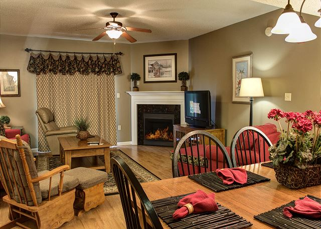 Hardwood in Living Room with Ceiling Fan, Flat Screen TV ,Gas Fireplace and Plenty of Seating