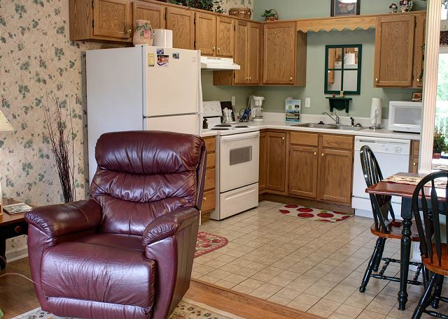 Full Kitchen and Recliner in Living Room