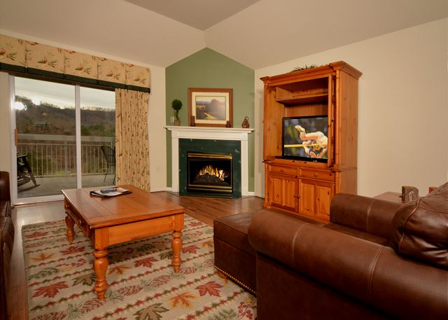 Hardwood in Living Room with Seasonal Fireplace and Flat Screen TV