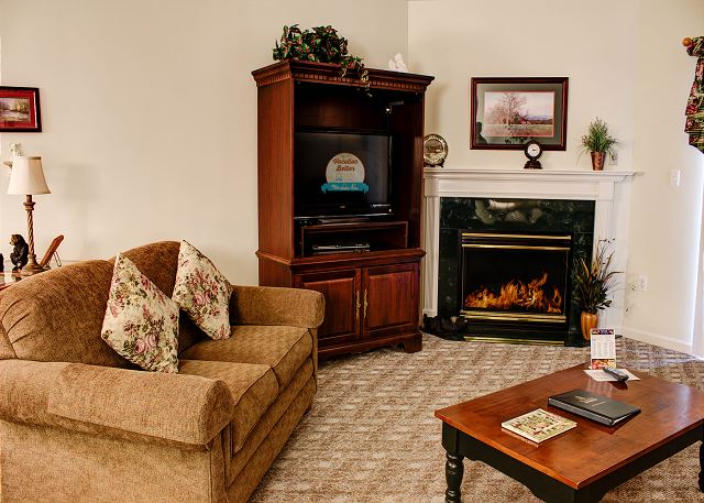 Living Room  with gas fireplace and flat screen t.v.