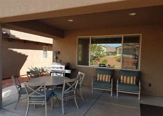 Patio off of Kitchen.  Grill.  Seating for 8