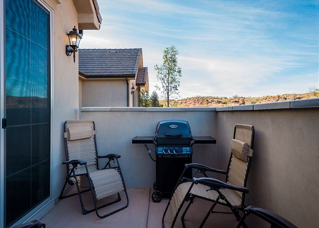 Patio with BBQ and chairs