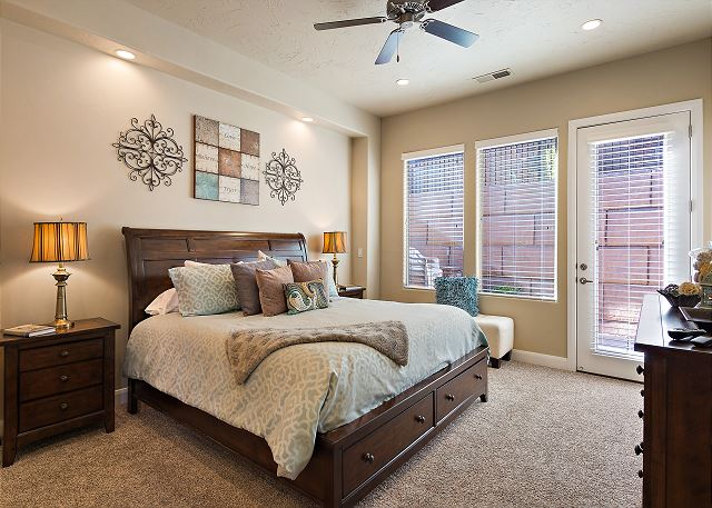 Master bedroom with King & TV/Private access to patio