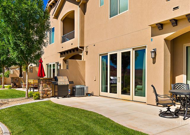 Back view of home, grill and patio seating