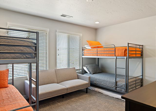 Kid's bunk room with futon.  TV and game station