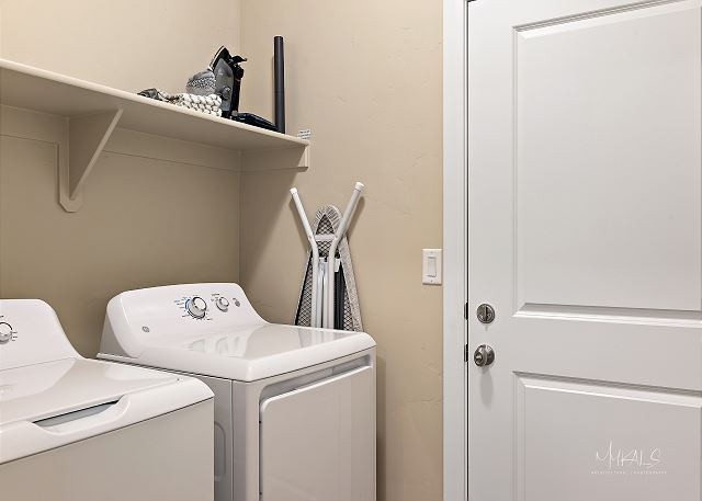Laundry room with full size washer/dryer