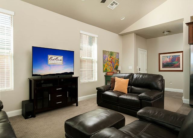 Living Room, comfy leather seating.  Flat screen TV.
