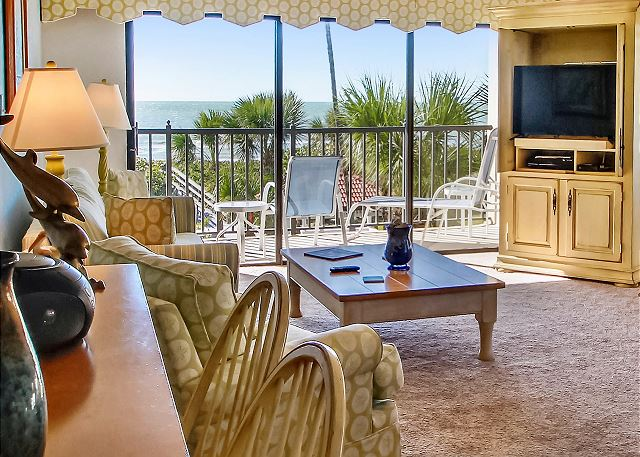 Large sliding doors opening up to the beach front balcony with a stunning view!