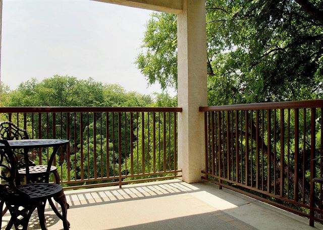 This river front unit offers a large private patio with amazing views of the Comal River and Inverness grounds!