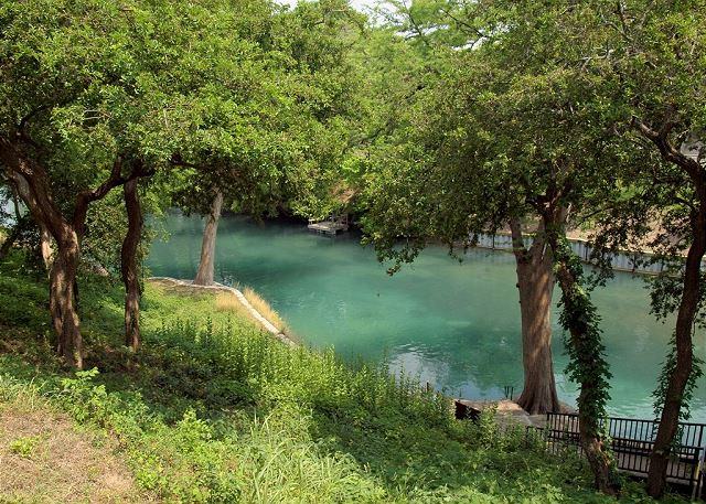 Take in the beautiful view of the Comal River right from the covered patio!