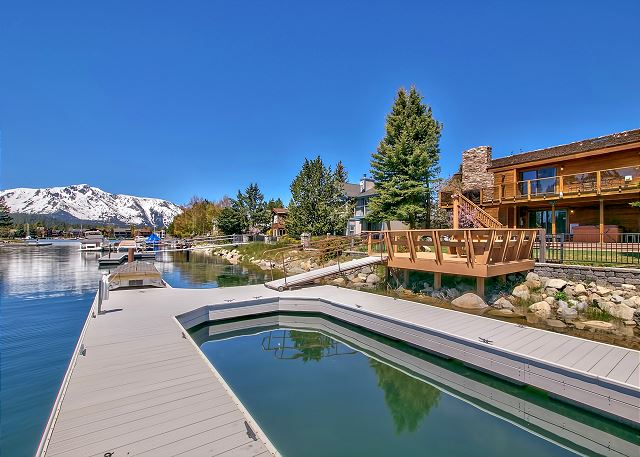 Relax in luxury at this home with views, boat docks galore, BBQ, hot tub, private sauna, pool table, and perfection throughout!