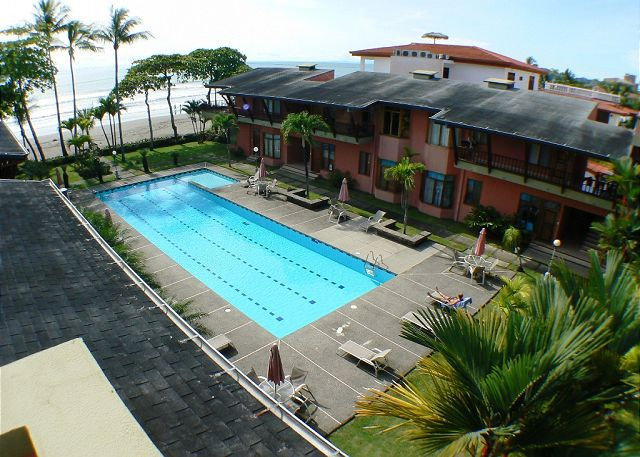 Largest beachfront pool in Jaco viewed from our MarArena beachfront vacation rental penthouse condo in Jaco, Costa Rica