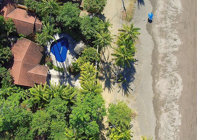 Aerial view from above Casa Milagro vacation rental villa on the beach in Jaco, Costa Rica