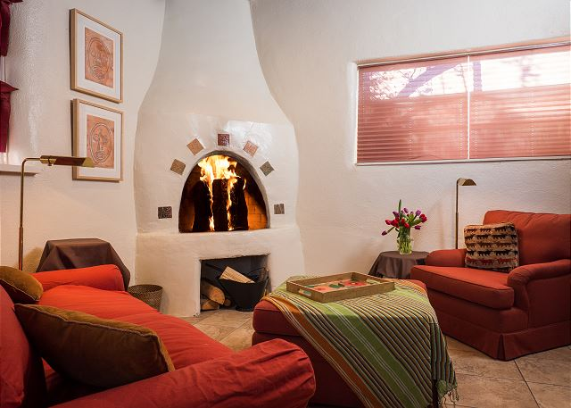 Enjoy a relaxing time in front of the kiva fireplace