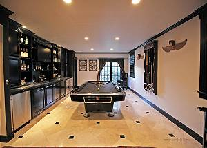 Finished lower level with pool table and bar