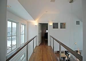 Bridge from second floor King bedroom to media room
