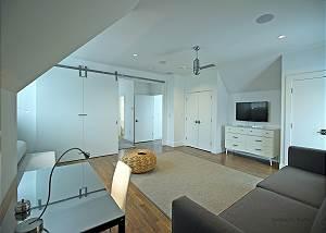 Another view of Queen floor bedroom living room