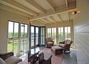 Detached sun room overlooking pool  yard
