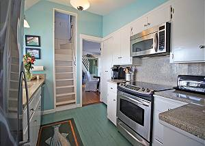 Kitchen with staircase to bedroom with 1 twin