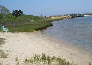 Small Beach in front of house wDike Bridge in background