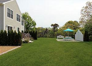 View of shared patio and yard