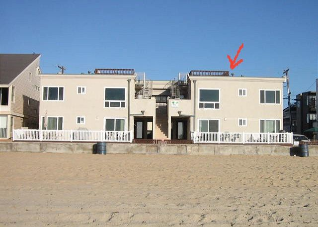 Upper Unit on the South Side with windows facing the sunset, sand, and surf!