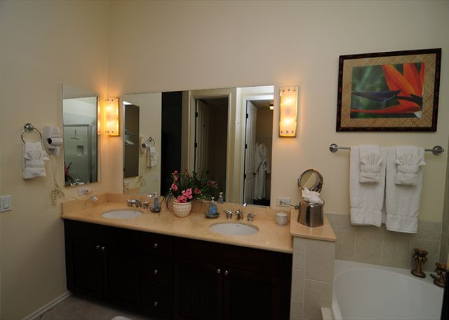 Features Double Sinks with Separate Shower, Soaking Tub, Makeup Mirror, Hairdryer, Iron and Ironing Board, Bathrobes too!