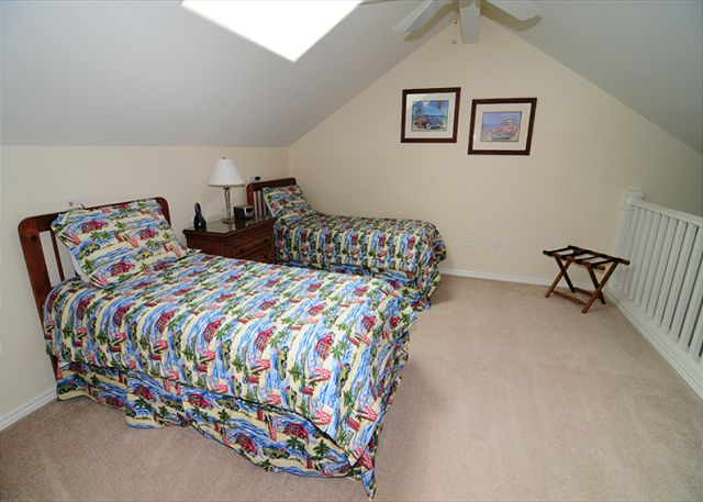 This bedroom features 2 Twin Beds with optional King Bed upon request at time of booking.