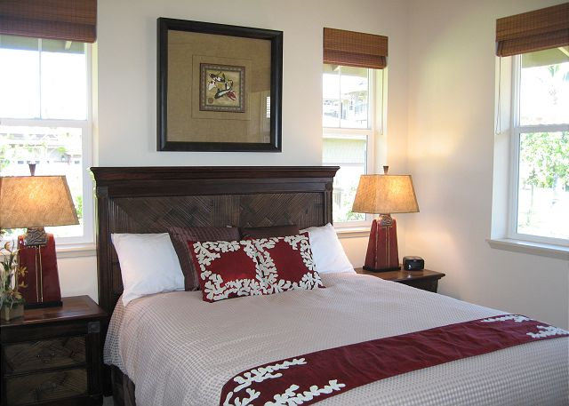 Luxury Queen Bedroom features desk area with FREE wifi and Flat Panel TV/DVD.