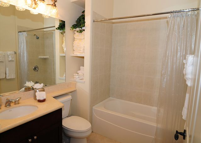 This hall bathroom includes tub/shower combo, bath linens, beach towels and hairdryer too!