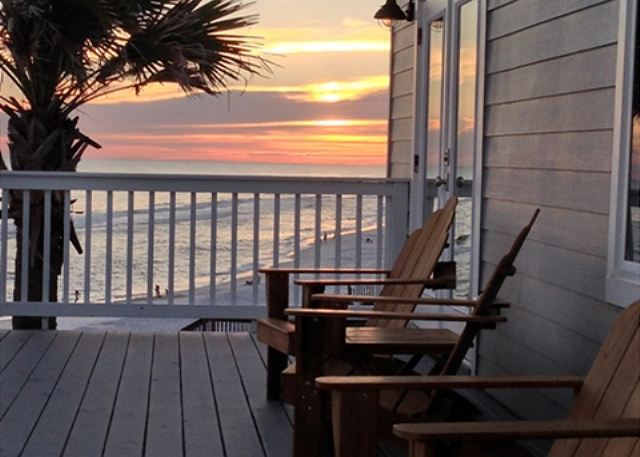 Watch the sun set from your private beach front balcony!