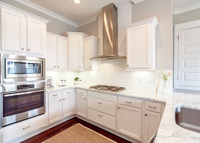 Gourmet Kitchen with Stainless Vent Hood