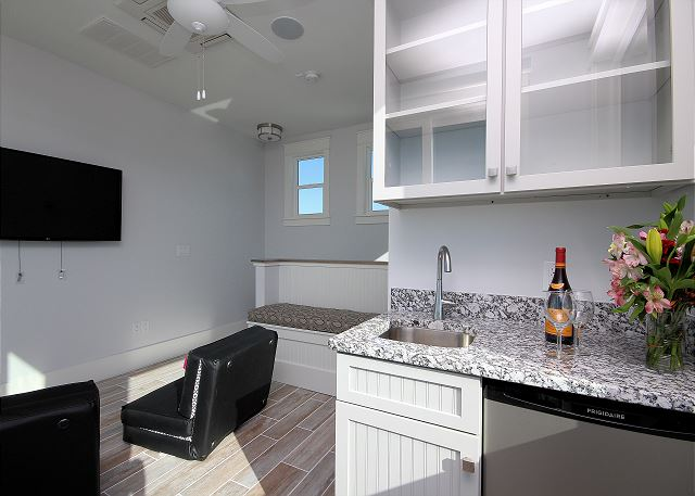 Tower with Wet Bar, Mini Fridge, & Flat Screen TV
