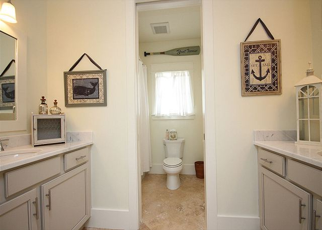 Guest Bathroom with Dual Sinks and Bath/Shower Combo