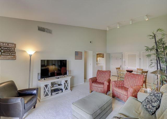Bluff Villas 1817 - Living room with Flat Screen TV & Private Balcony - HiltonHeadRentals.com