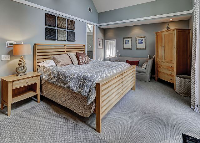 Master Bedroom with bed, Flat Screen TV & Private Bath