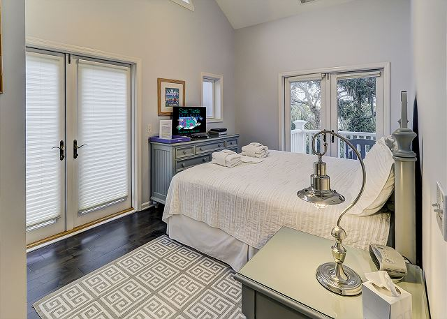 Sandpiper 30 - Bedroom 6 with King Bed, Flat Screen TV & Private Bath - HiltonHeadRentals.com