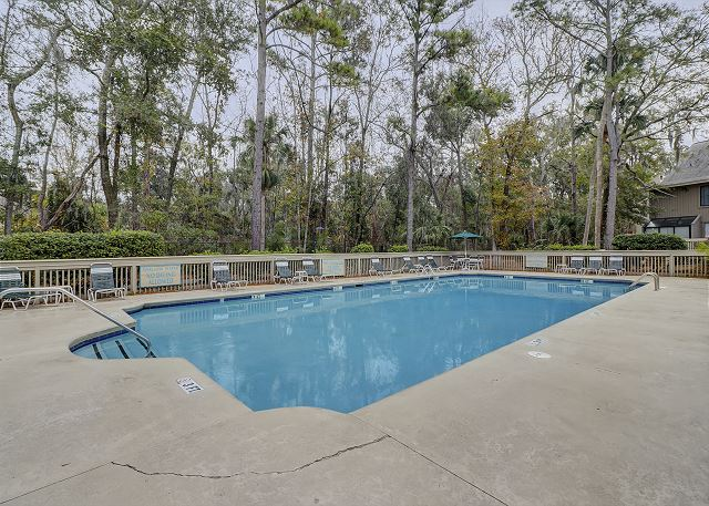 Beachwalk 204 - Sunny Pool with ample Lounge Chairs - HiltonHeadRentals.com