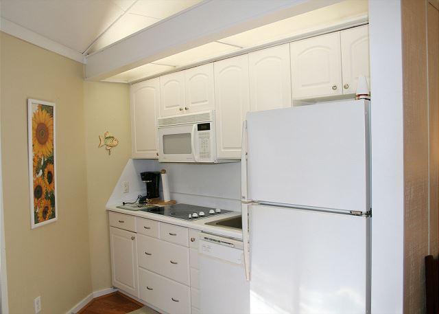 Night Heron 10 - Kitchen with Refrigerator, Dishwasher & Microwave - HiltonHeadRentals.com