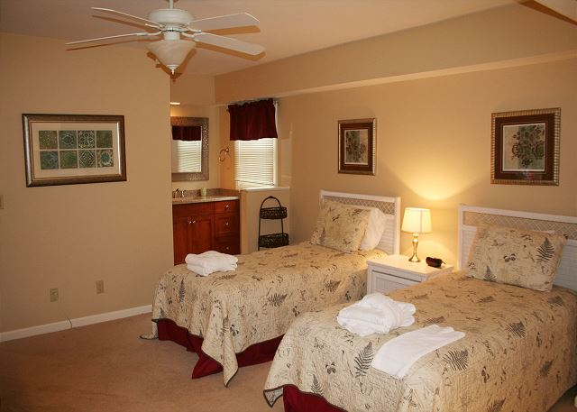 Evian 240 - Bedroom 3 with twin beds, TV & Private Bath - HiltonHeadRentals.com
