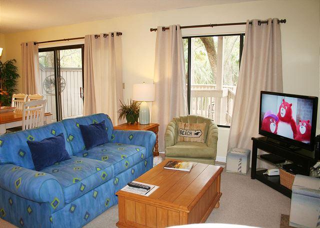 Comfy Living Room with Flat Screen TV & Sleep Sofa