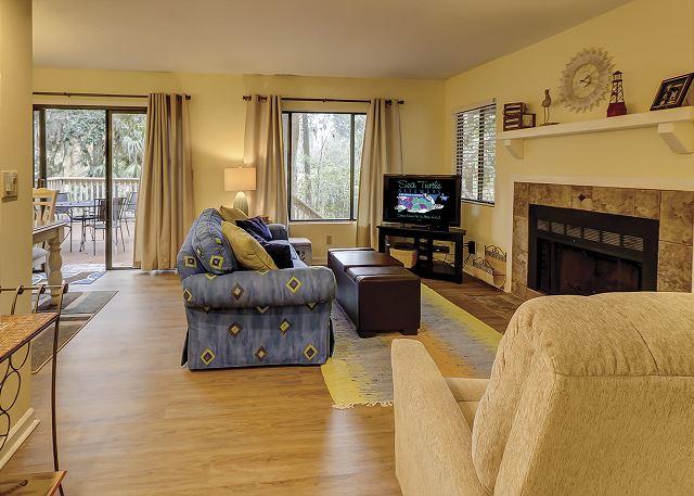 Beachwalk 204 - Living Room with Flat Screen TV & Queen Sleep Sofa - HiltonHeadRentals.com