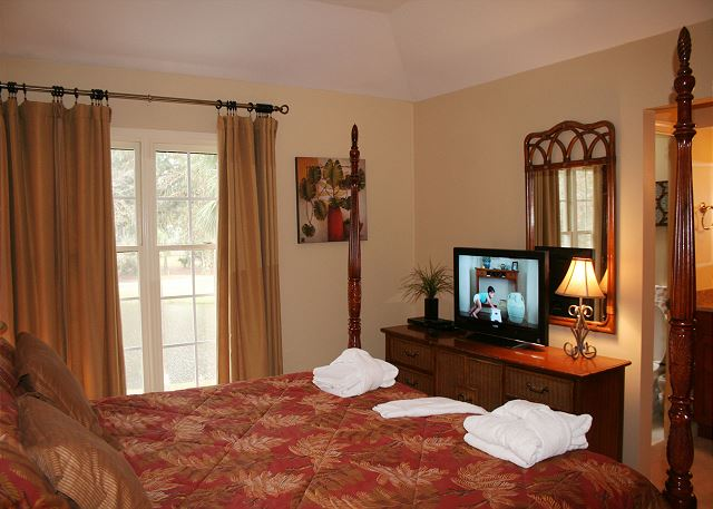 Evian 240 - Master Bedroom Flat Screen TV - HiltonHeadRentals.com
