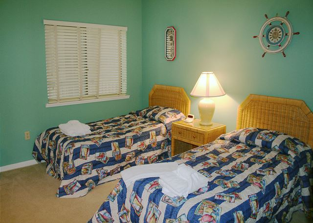Bedroom 2 with Twin beds. Flat Screen TV & Hall Bath