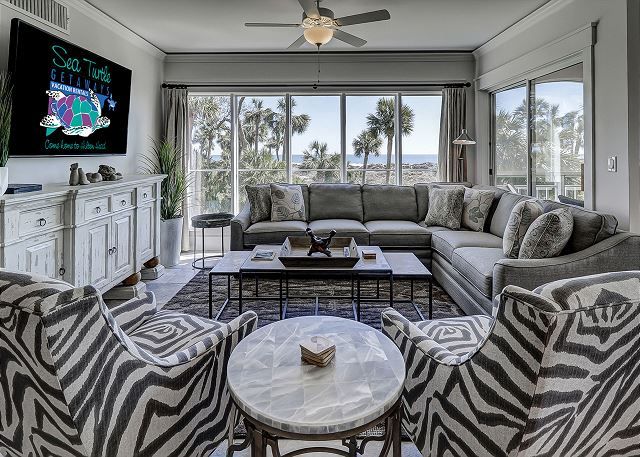 Ocean View Living Room with Flat Screen TV