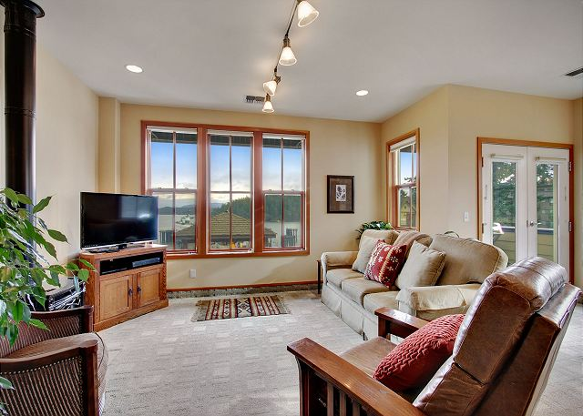 The tv area features a flat screen tv & DVD player & harbor views.