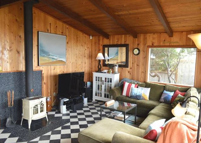Living room with spectacular ocean front views, flat screen cable  TV/VCR/DVD with Apple TV and surround sound, glass front wood stove and  large sectional. - Manzanita, OR United States - OCEAN'S DOORSTEP ~ MCA# 1121