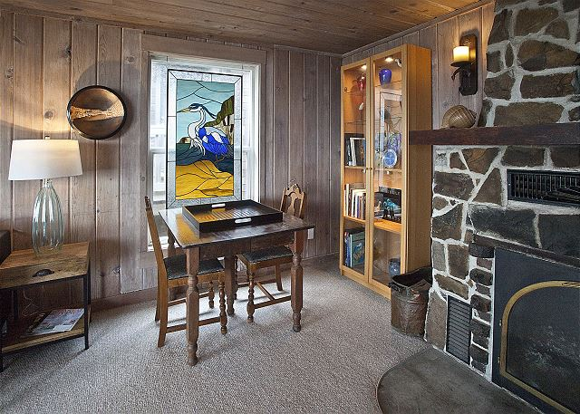 Puzzle and game lovers' corner! Build a crackling fire in the original wood-burning fireplace and Game On!
